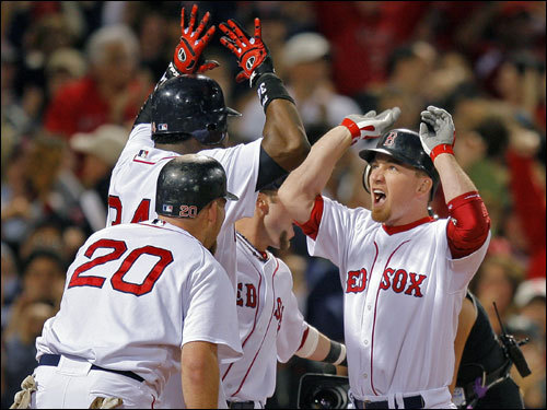JD Drew celebrates his grand slam in game six of the ALCS